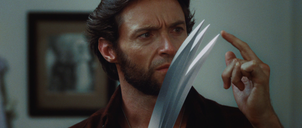 Logan_examines_his_new_Adamantium_Claws